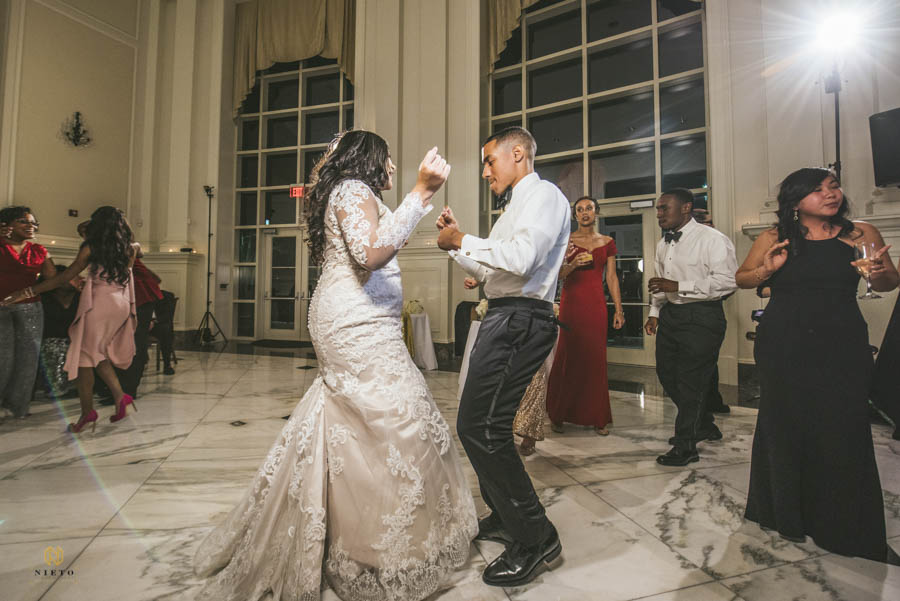 bride and groom dancing together during their wedding reception at NC Alumni Club