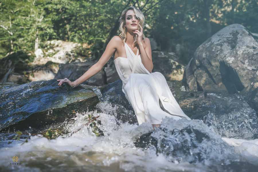 Eno River Bridal Portrait of modeling sitting on a rock with water streaming over it