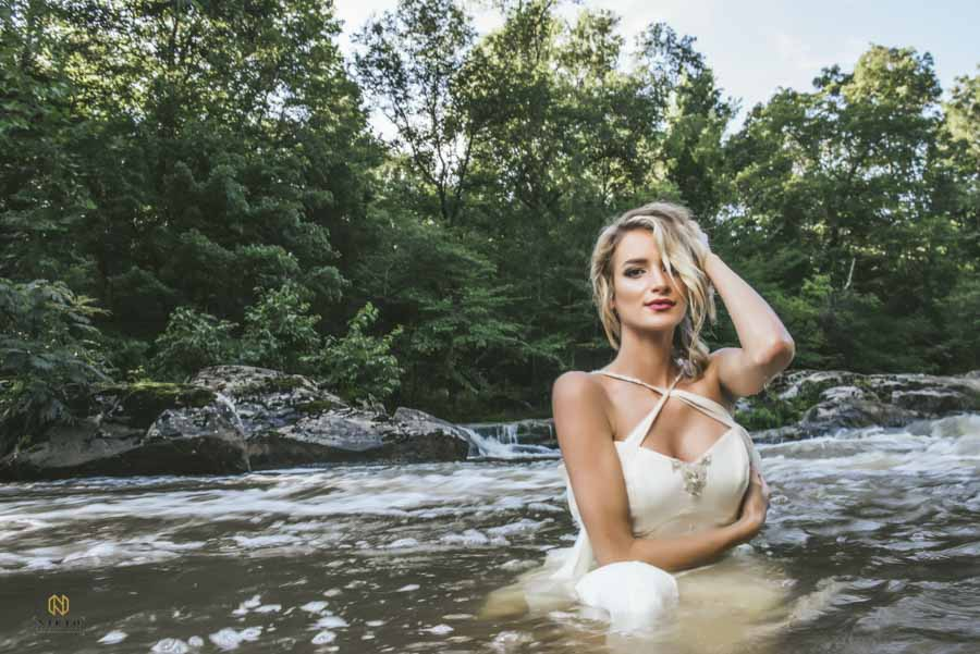 blonde bridal model posing in the middle of the Eno River