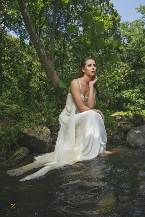 Eno River Bridal Portrait of model sitting on the river bank