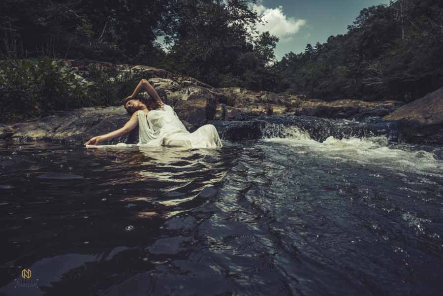 Eno River Bridal Portrait of a model leaning back on a rock