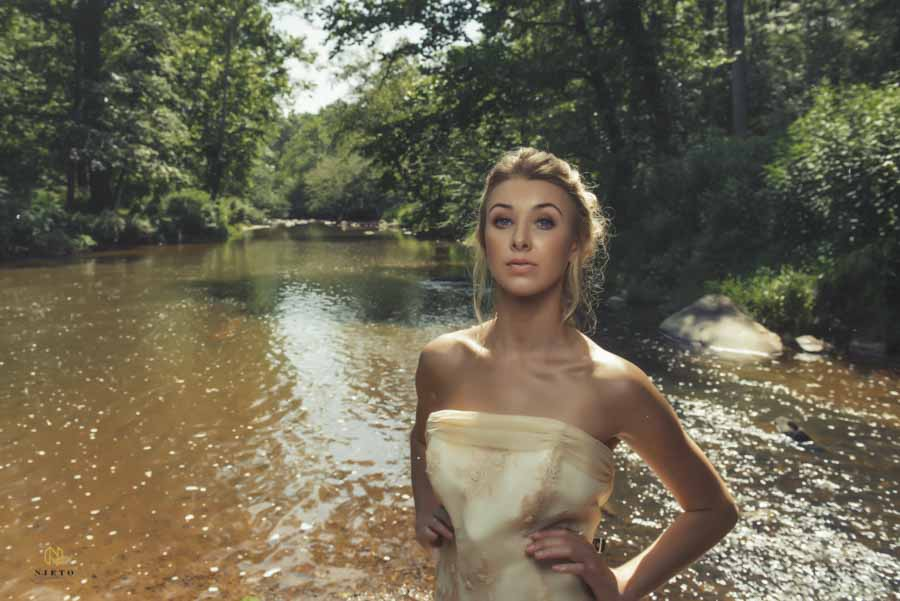 model standing in the middle of the eno river with her hands on her hips