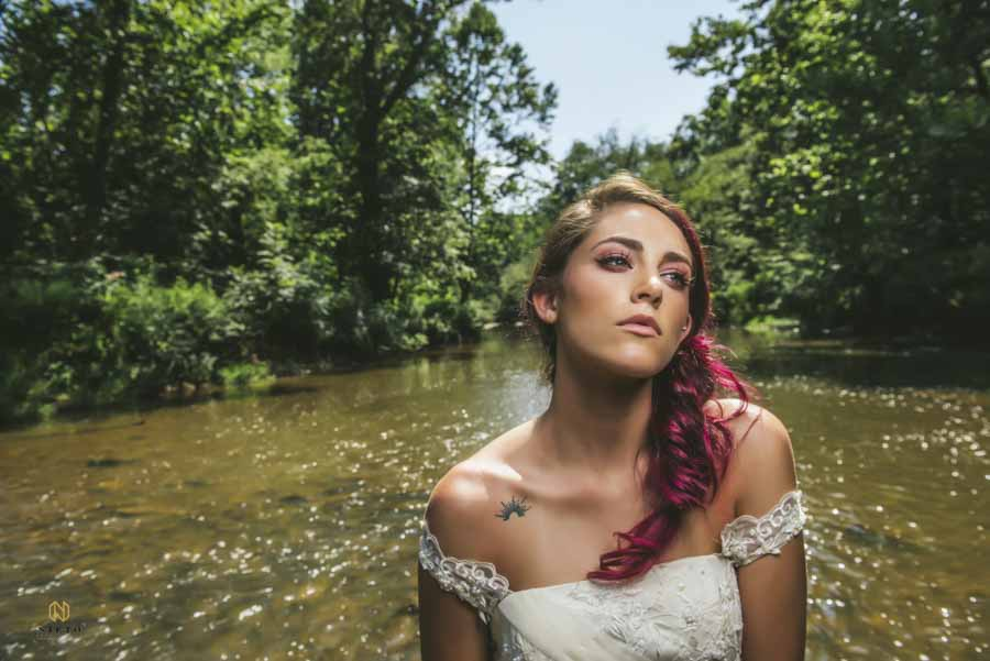 model with purple hair posing for an Eno River bridal portrait