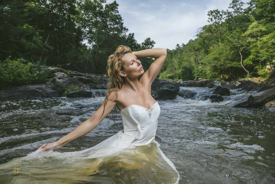 woman posing in the Eno river for her bridal portrait