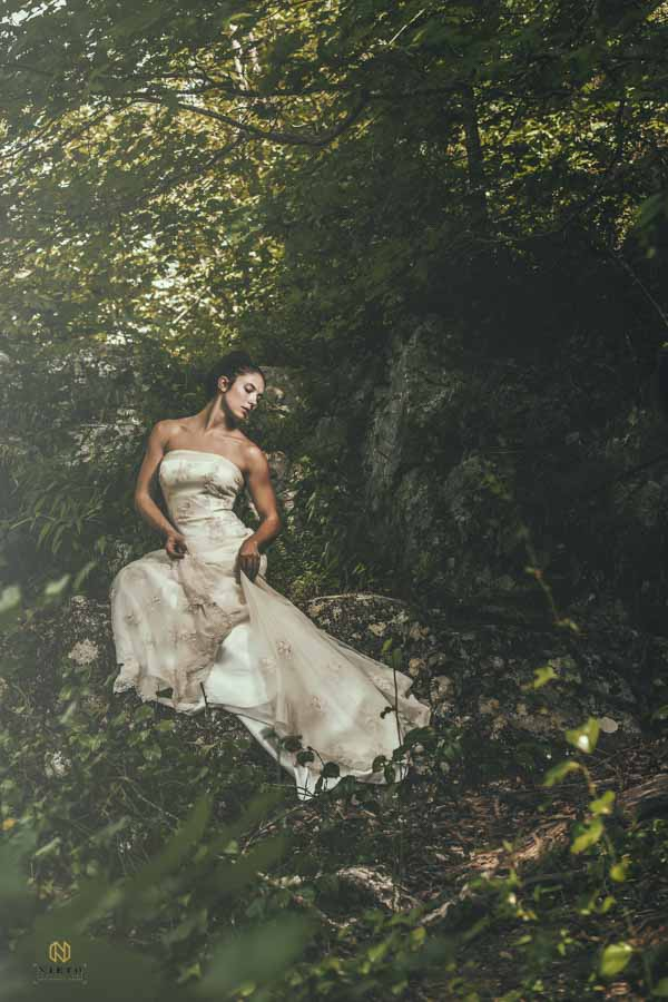 woman posing in her bridal gown at the eno river