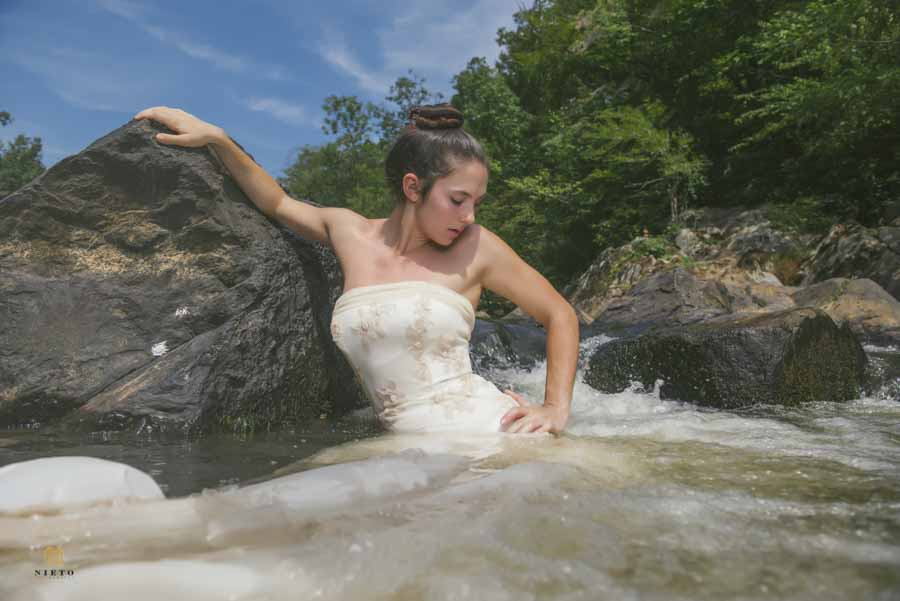 woman in her wedding dress in the river