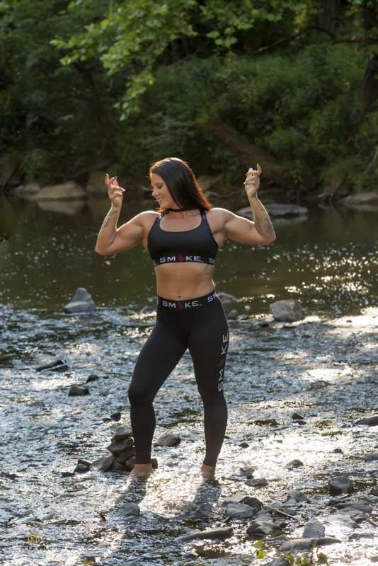 Fitness competitor posing in the Eno River for a athletic portrait