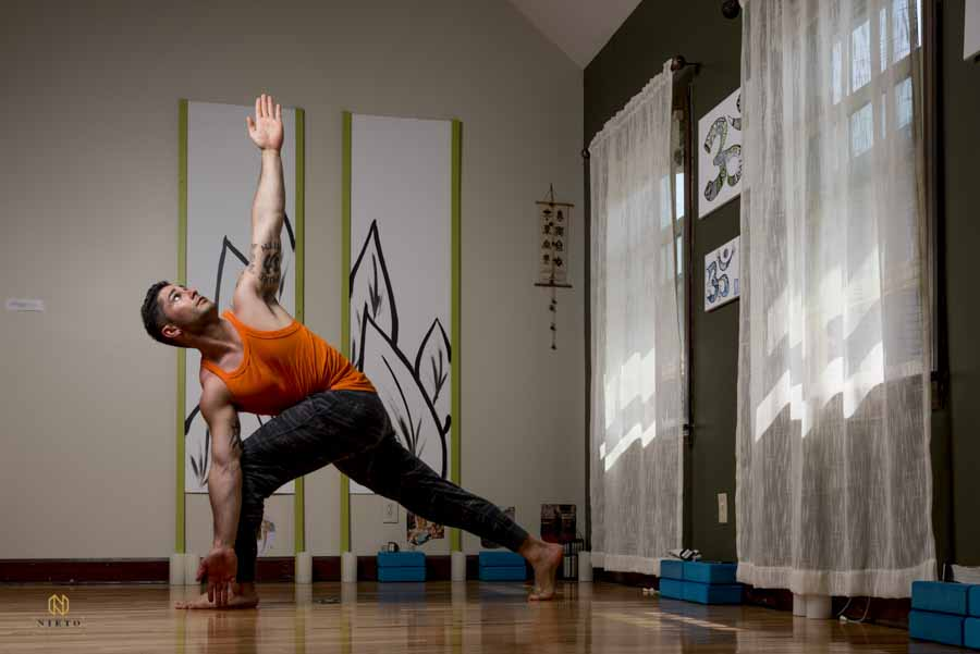 Yoga instructor posing for a portrait in his studio