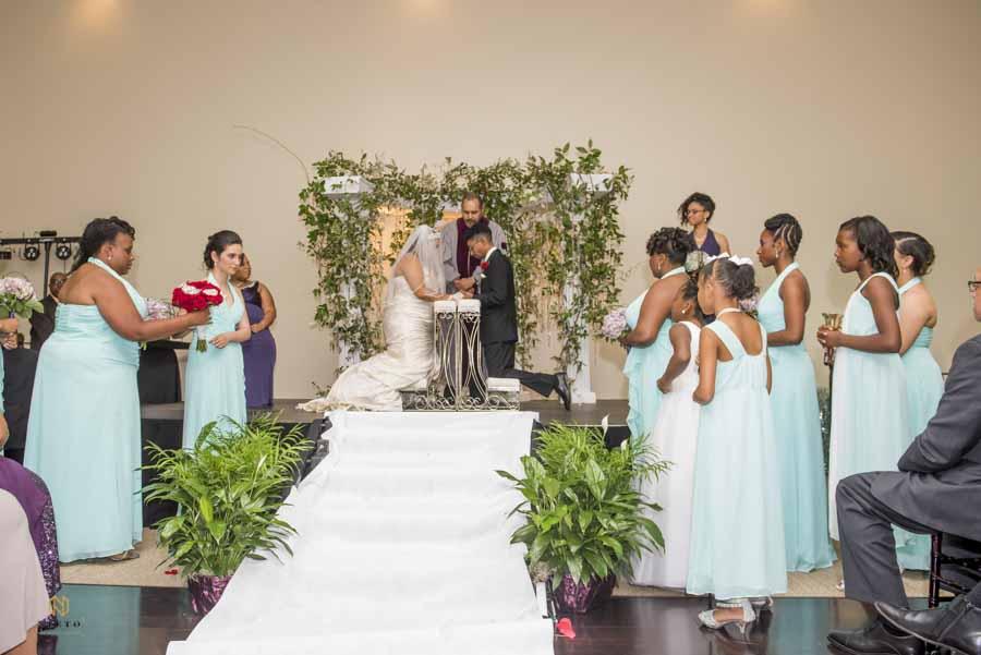 indoor wedding ceremony at the garden on millbrook