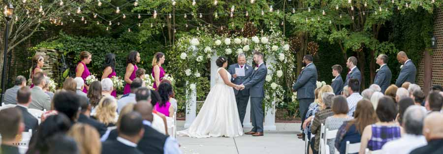 panorama of a patio wedding at the garden on millbrook