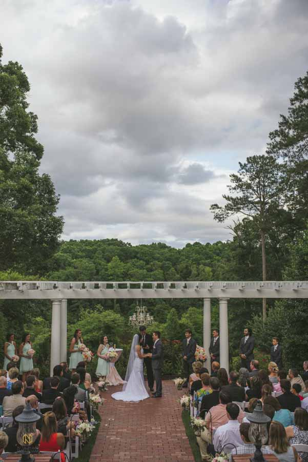 bride and groom holding hands during their wedding ceremony at the Highgrove Estate