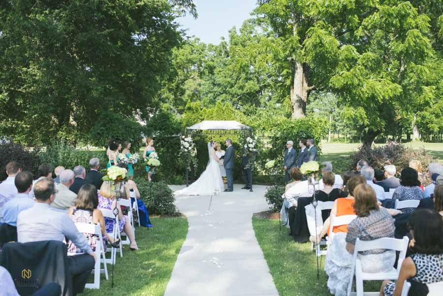 Hudson Manor garden ceremony with bride and groom holding hands