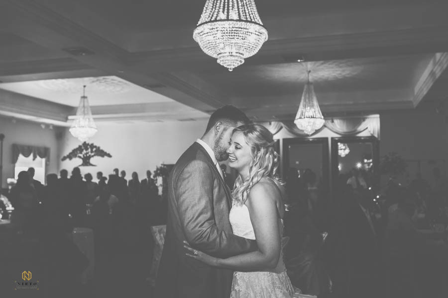 Black and white image of the bride and groom dancing in the ballroom of The Hudson Manor
