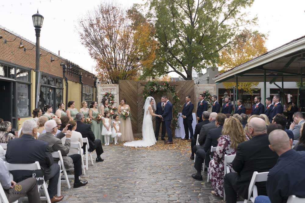 bride laughing during her outdoor Market Hall wedding