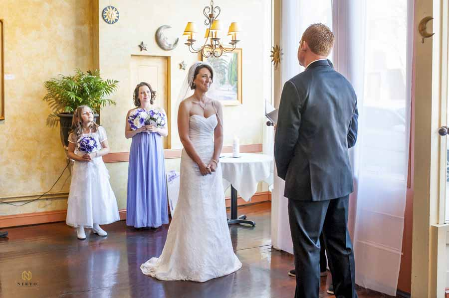 bride smiling at the groom during their Caffe Luna wedding ceremony