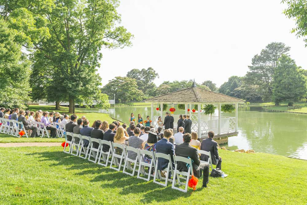 wedding guest sitting in front of a gazebo during the wedding ceremony at Rose Hill