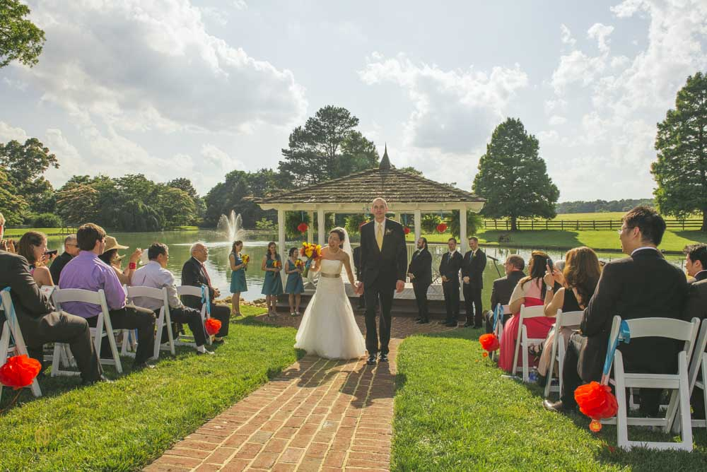 bride and groom walking down the aisle at their rose hill wedding ceremony