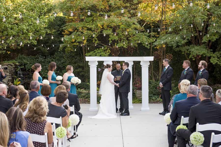 Garden on Millbrook wedding ceremony on the outdoor patio
