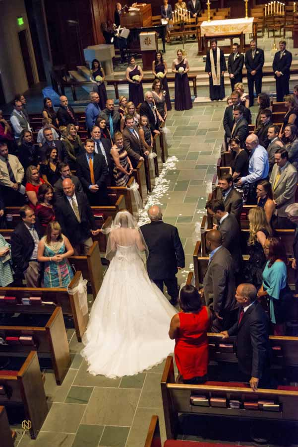the bride and her father walking down the aisle at Hayes Barton United Methodist Church