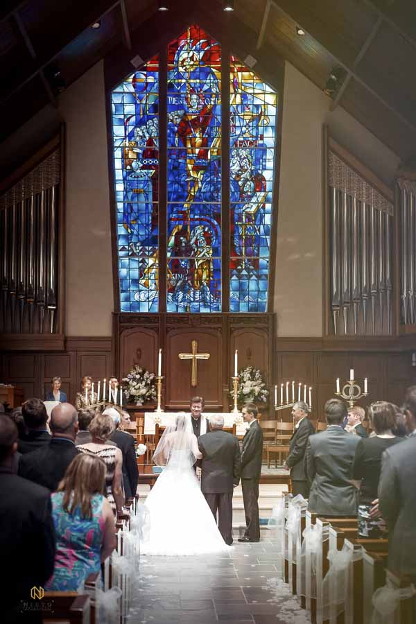 Hayes Barton United Methodist wedding ceremony in front of the stained glass windows