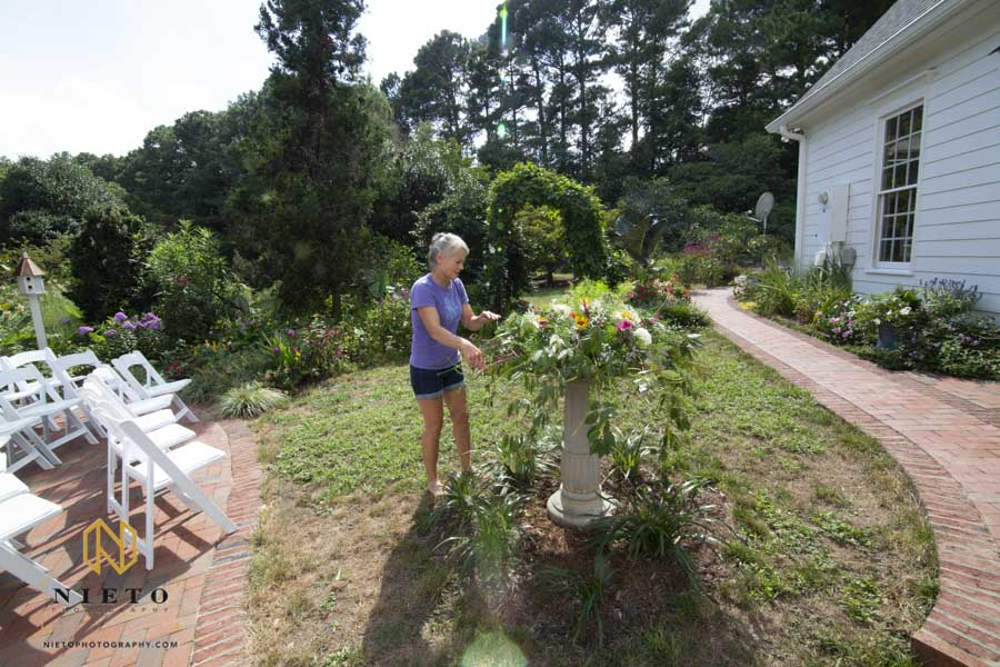 mother of the bride trimming the yard floral center piece