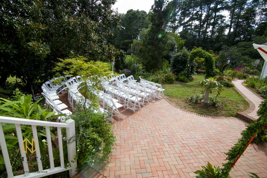 wide view of the ceremony site for a backyard garden wedding
