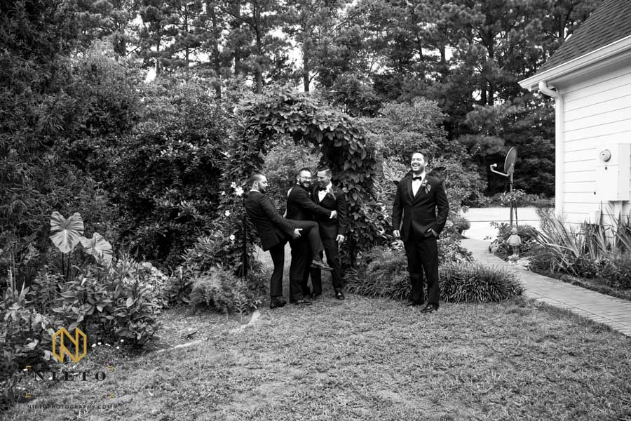 black and white image of the groomsmen acting up
