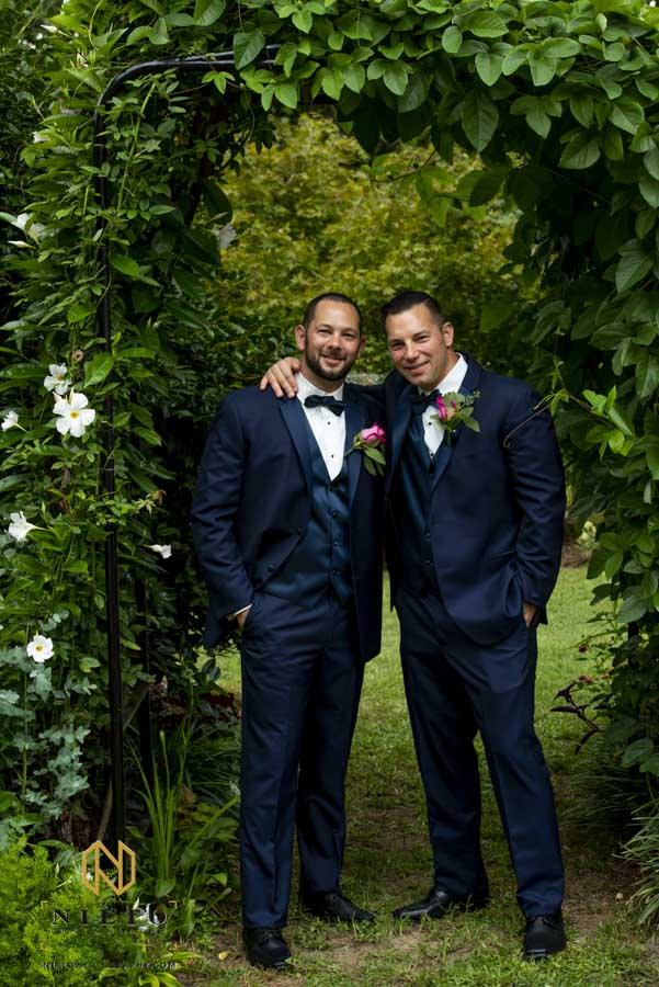 groom posing with his best man for a portrait