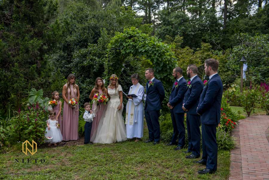 full shot of the wedding party during the backyard garden wedding ceremony