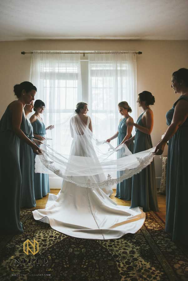 bridesmaids adjusting the brides veil inside the Hudson Manor