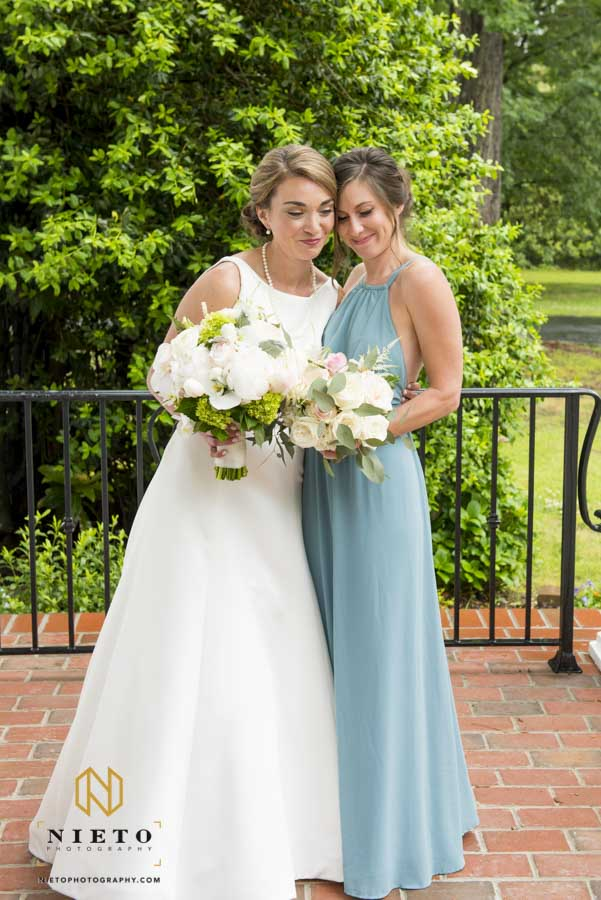 bride and bridesmaid hugging each other