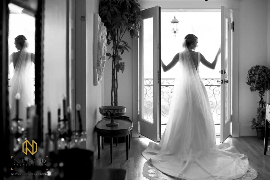 black and white image of the bride in the balcony of the Hudson Manor