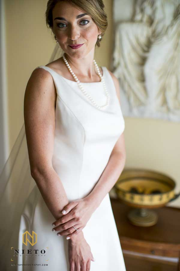 bride posing for a portrait inside of the Hudson Manor
