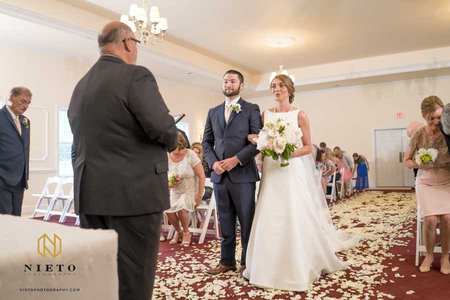 bride and groom standing at the alter in the Hudson Manor chapel