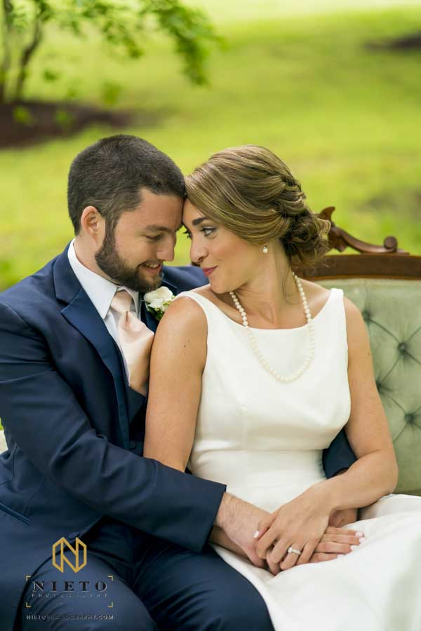 bride and groom looking at each other as they sit together