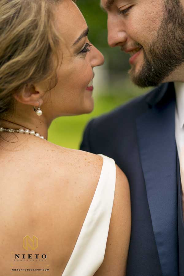 close up of bride and groom about to kiss