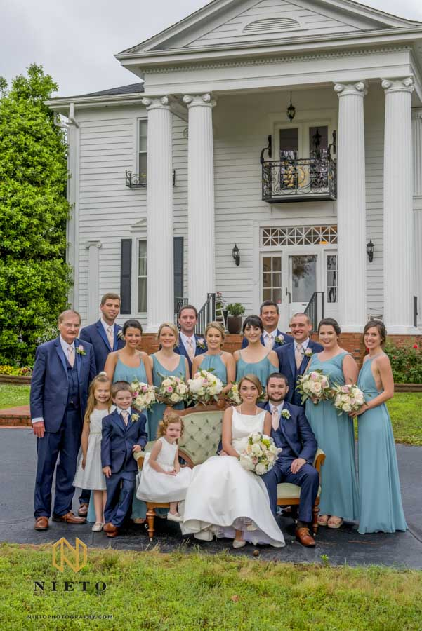 formal bridal party portrait in front of the Hudson Manor