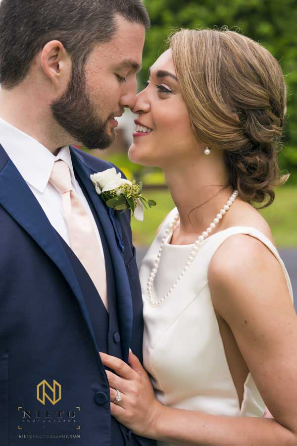 bride and groom rubbing noses together at the Hudson Manor