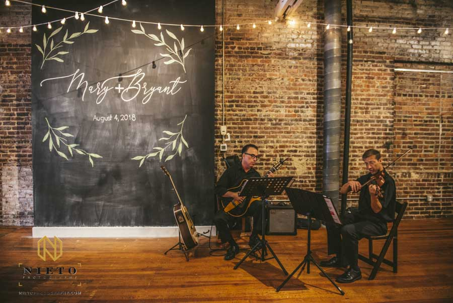 chalk board and string players at the stockroom wedding