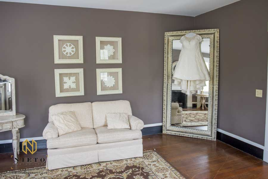 brides dress hanging from the mirror in the bridal suite at the Sutherland