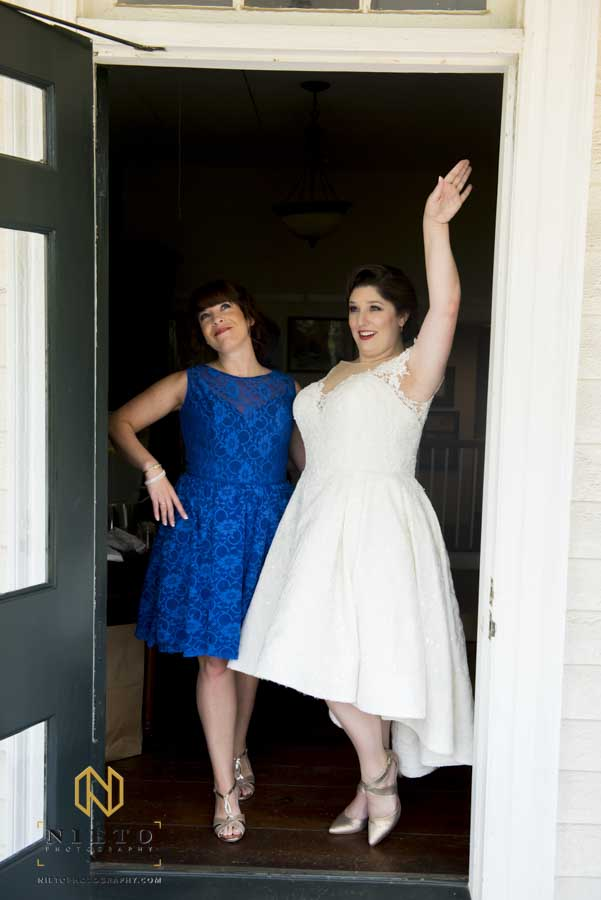 bride and bridesmaid being silly for a portrait at the Sutherland