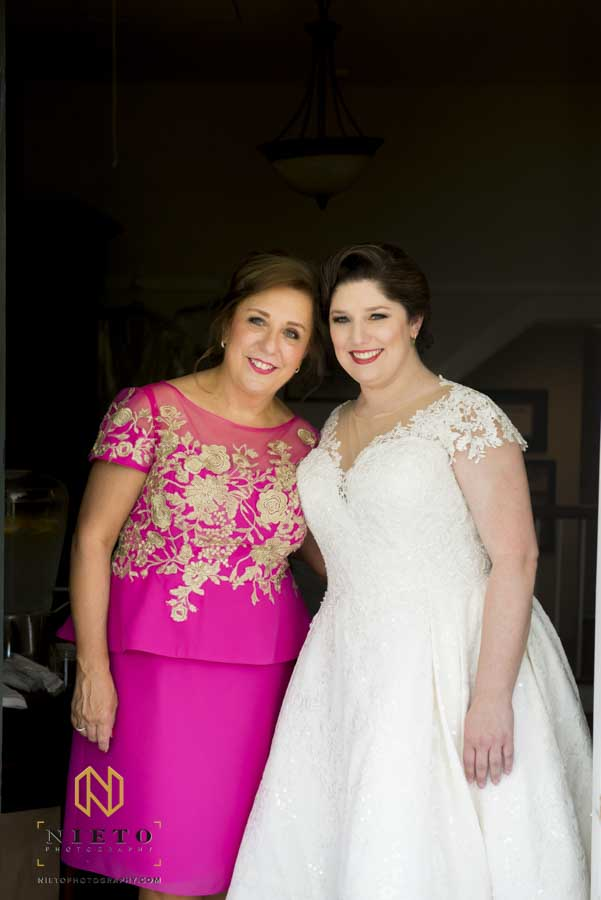 bride and her mother posing for a portrait inside the Sutherland