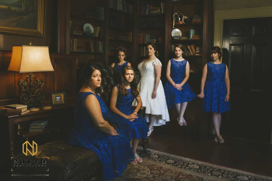 portrait of the bridal party inside the library at the Sutherland