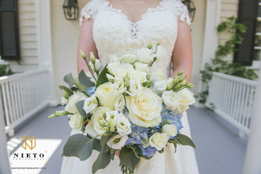 bride showing off her bridal bouquet from the Purple Poppy