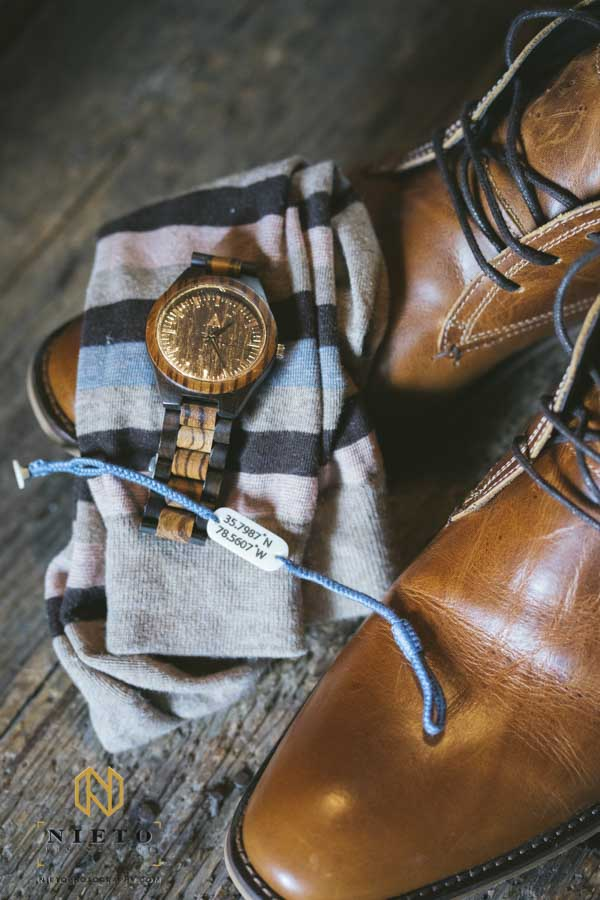 detail shot of the groom shoes, socks, watch, and bracelet