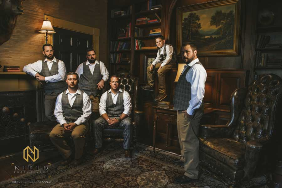 portrait of the groom and groomsmen inside the library at the Sutherland