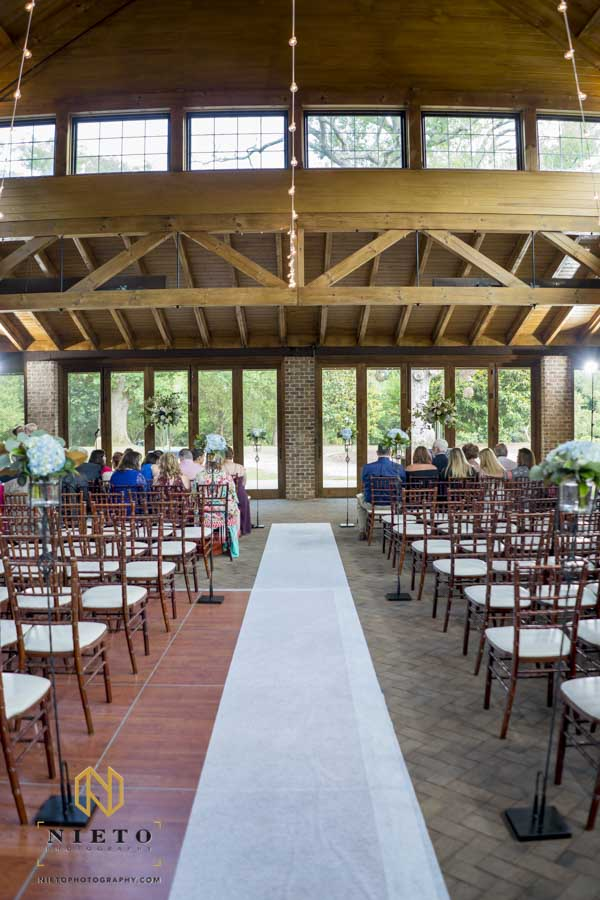 picture of an indoor pavilion Sutherland wedding with a white runner