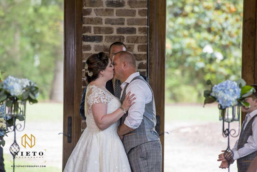 bride and groom kissing at their ceremony inside the pavilion at the Sutherland