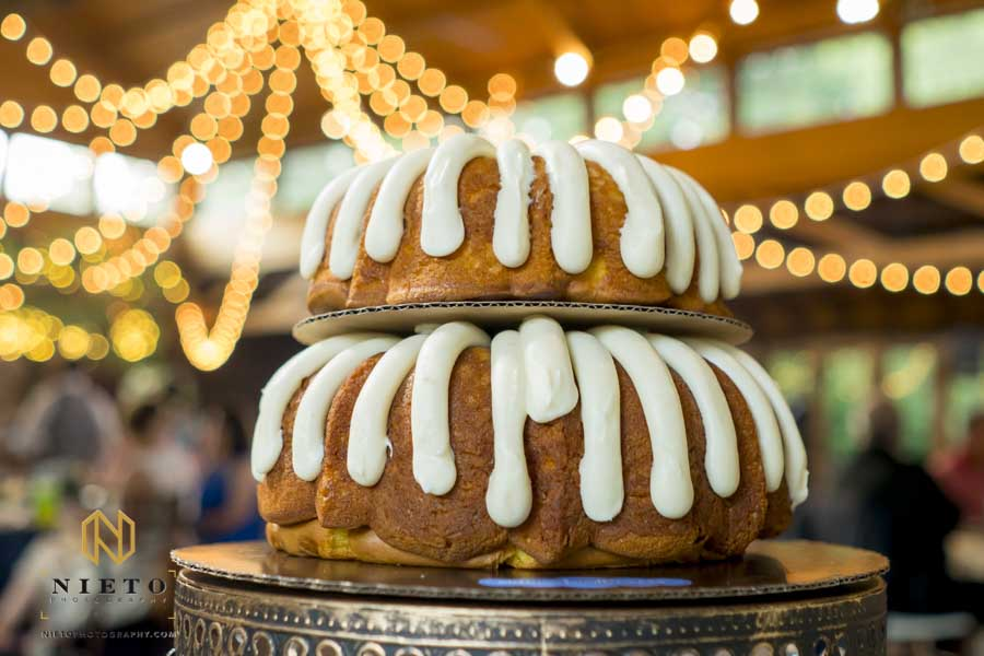 two their bundt cake on a pedastal at a Sutherland wedding reception