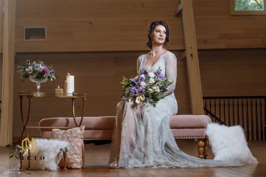 Wakefield Barn Bridal Portraits of a woman on a pink chair and candles beside her